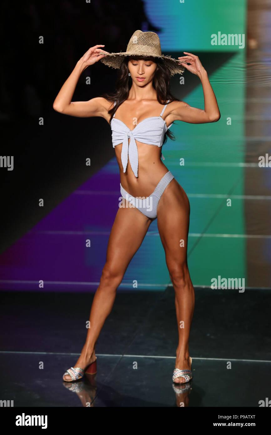 MIAMI BEACH, FL - JULY 15: A model walks the runway for