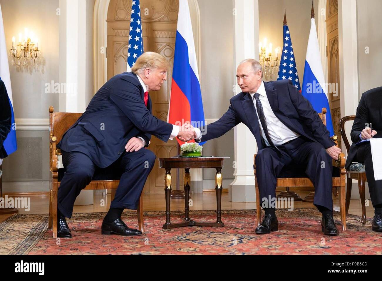 Russian President Vladimir Putin shakes hands with U.S. President Donald Trump during the U.S. - Russia Summit meeting at the Presidential Palace July 16, 2018 in Helsinki, Finland. - Stock Image