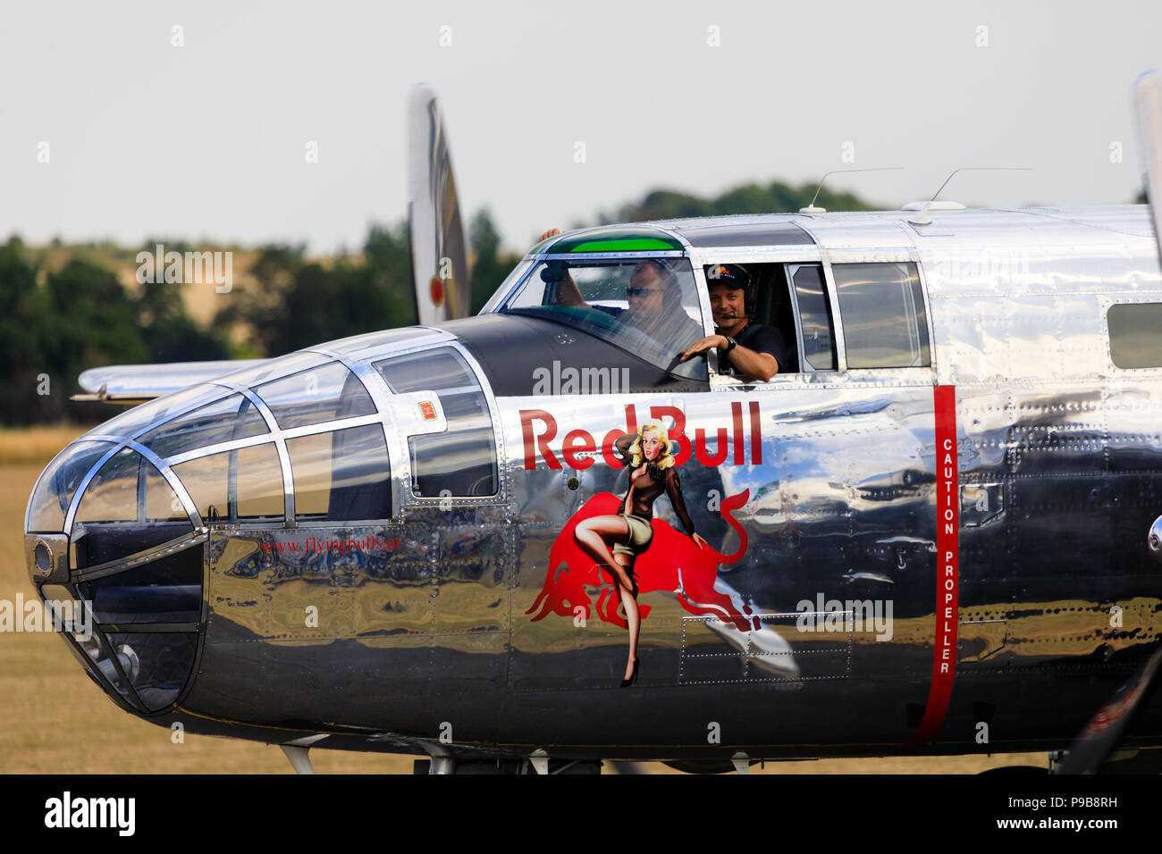 Red Bull North American B25J Mitchell medium bomber, N6123C. Crew waving to crowds at the end of a display. - Stock Image