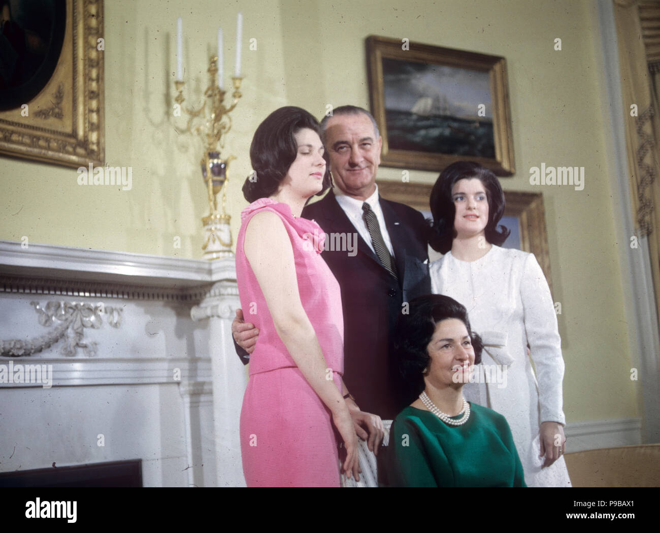 LYNDON B. JOHNSON (1908-1973) as 36th President of the United States with his wife Lady Bird and daughters Luci at left and Lyn about 1964 Stock Photo