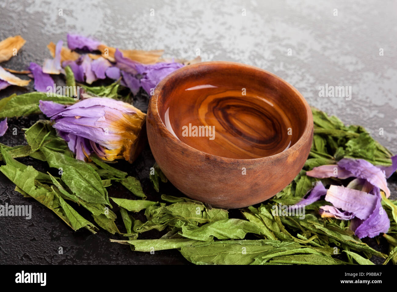 Dried Blue Lotus Flower With Dream Herbs And Oil Extract In Wooden