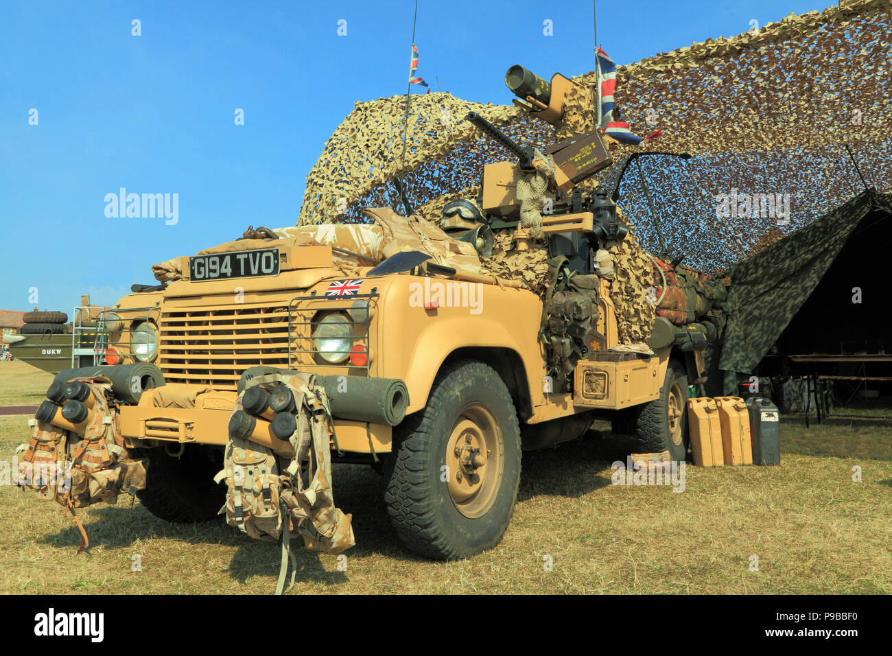 British, 1980s, Military Vehicle, Jeep, vintage, British Army, camouflage netting, tent, as served in Afghanistan War - Stock Image