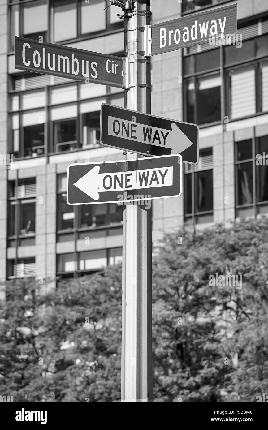 Black and white picture of Broadway and Columbus Circle street name signs, New York City, USA. Stock Photo