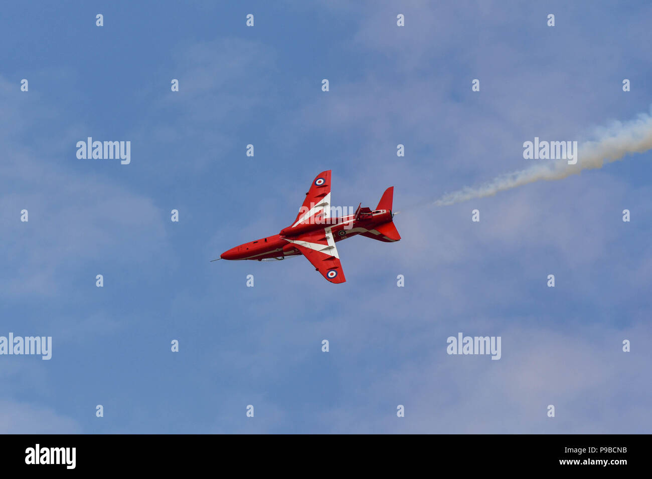 Single Hawk jet of the Royal Air Force aerobatic team, the Red Arrows, rolling at the Royal International Air Tattoo 2018 Stock Photo