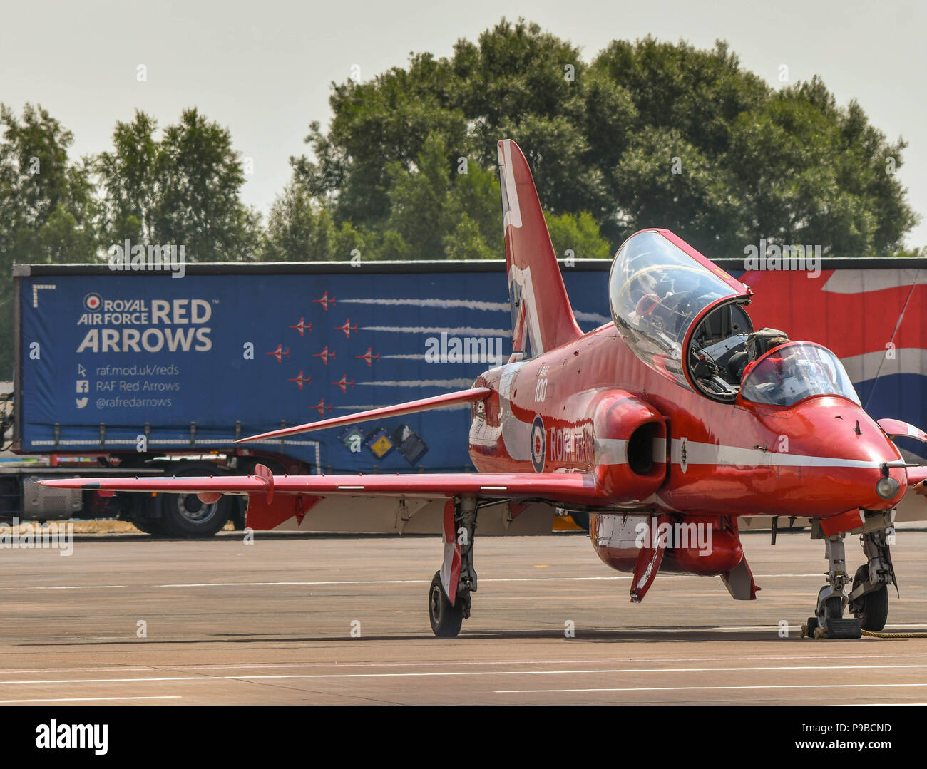 A Hawk jet of the Royal Air Force aerobatic team, the Red Arrows, at the Royal International Air Tattoo 2018. The team's lorry is in the background - Stock Image