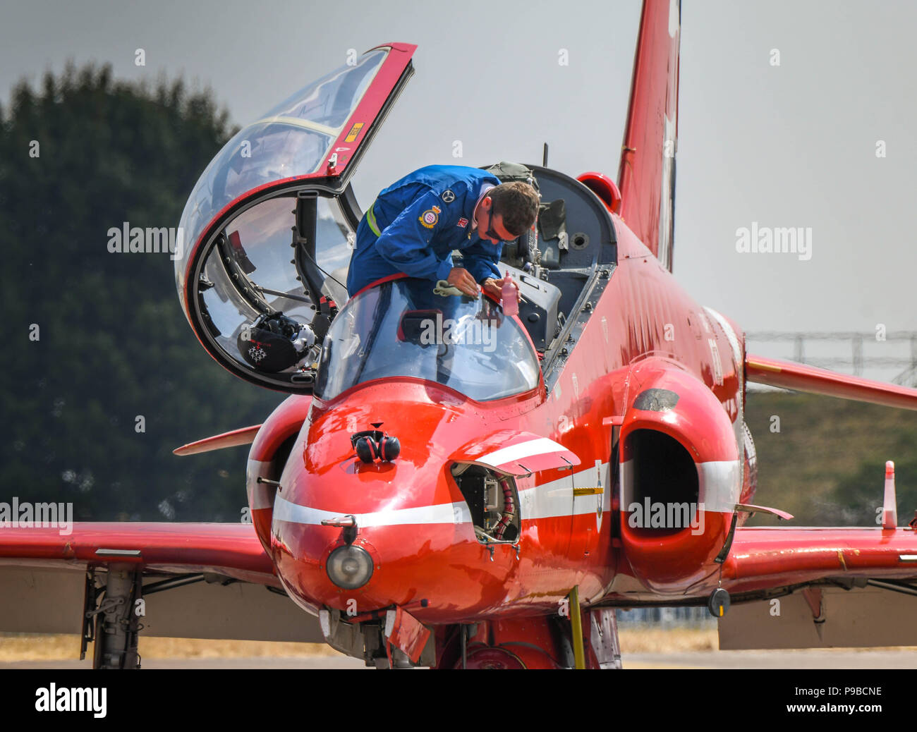 A Hawk jet of the Royal Air Force aerobatic team, the Red Arrows, at the Royal International Air Tattoo 2018. An engineer is cleaning the windscreen - Stock Image