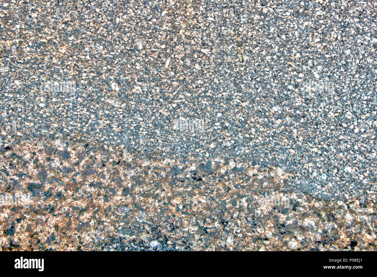 Multicolored natural stone texture, smooth granite surface, may be used as background - Stock Image