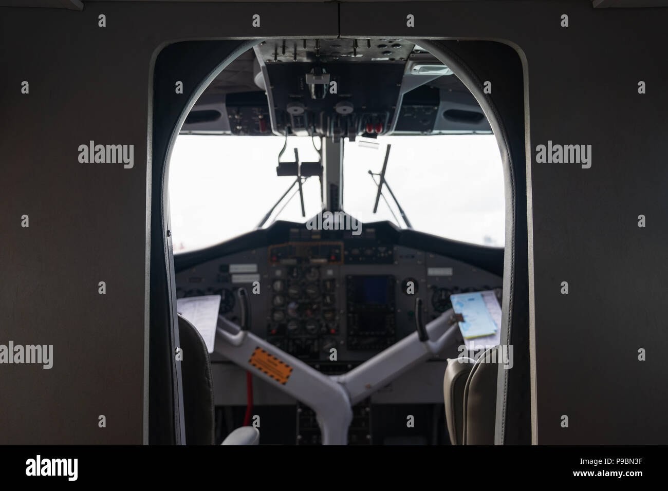 Interior details of airplane cockpit board control background, on white background. - Stock Image