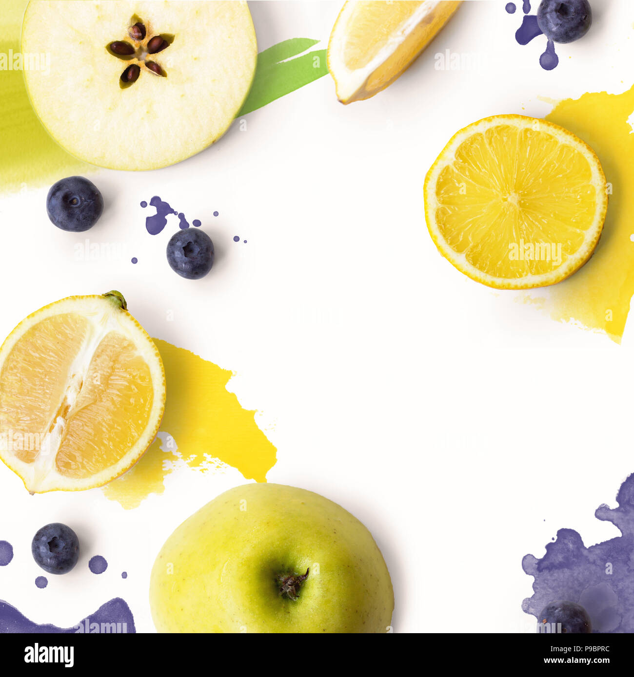 Green apple slices on white background with watercolor splashes; Fruit background - Stock Image