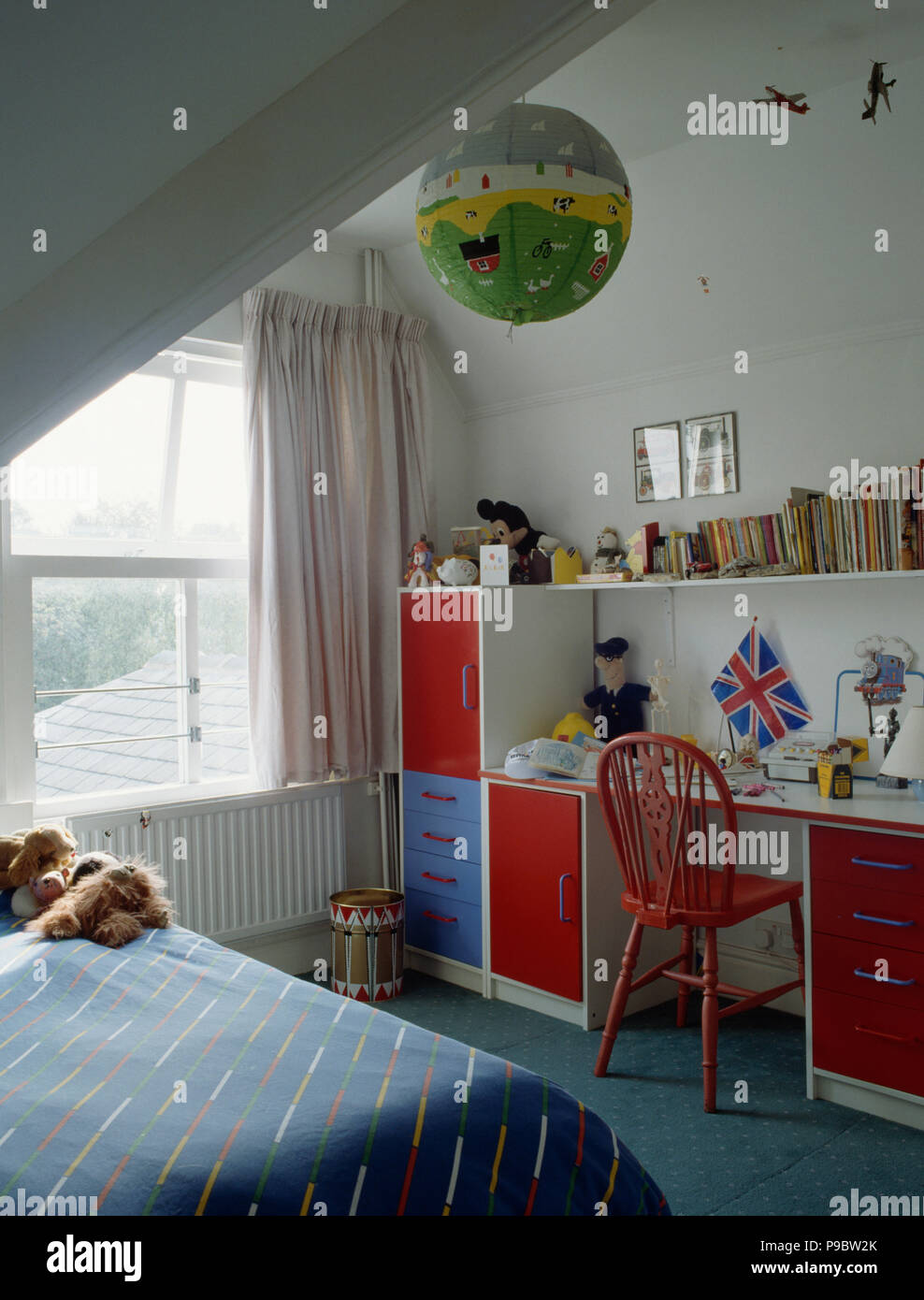 Red and blue storage units and integral desk in child\'s ...