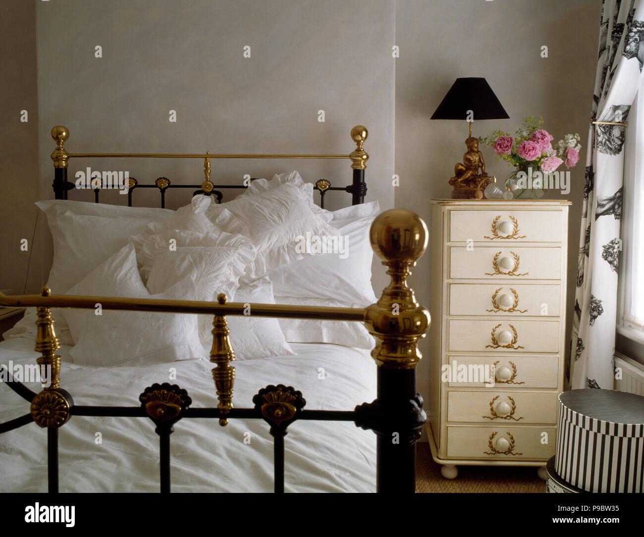 Antique Brass Bed And Narrow Chest Of Drawers In Eighties Bedroom