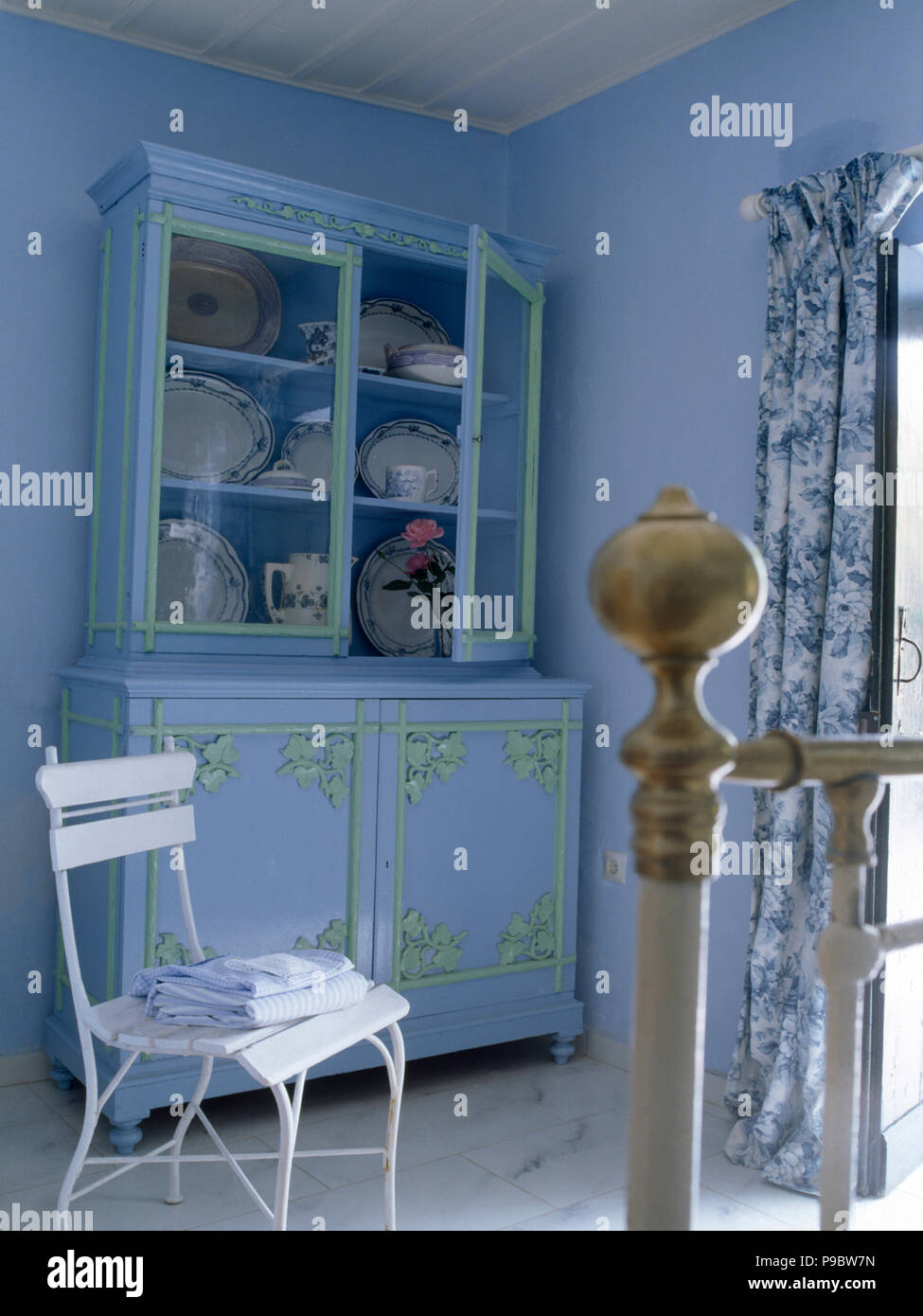 White chair and pale blue painted dresser in a pale blue ...