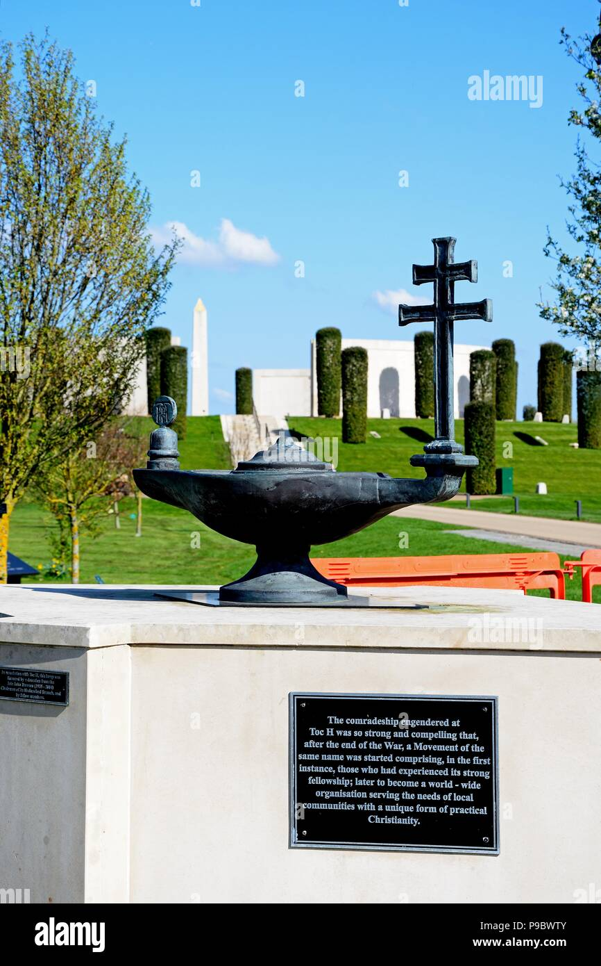 Front view of the Armed Forces Memorial with landscaped gardens and the Toc H Christian lamp memorial in the foreground, National Memorial Arboretum,  - Stock Image