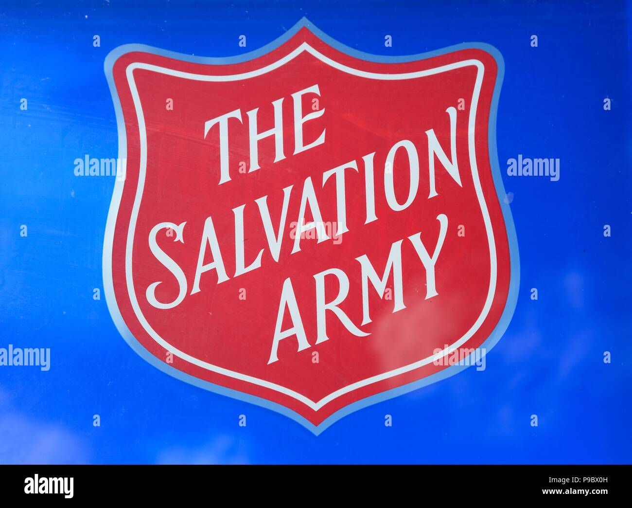 The Salvation Army shield against a blue background to the rear at the National Memorial Arboretum, Alrewas, Staffordshire, England, UK, Western Europ - Stock Image