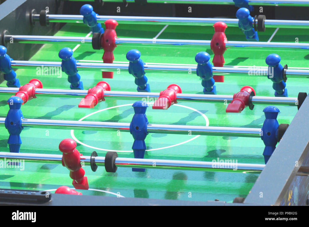 People play kicker table football soccer. Table soccer - Stock Image