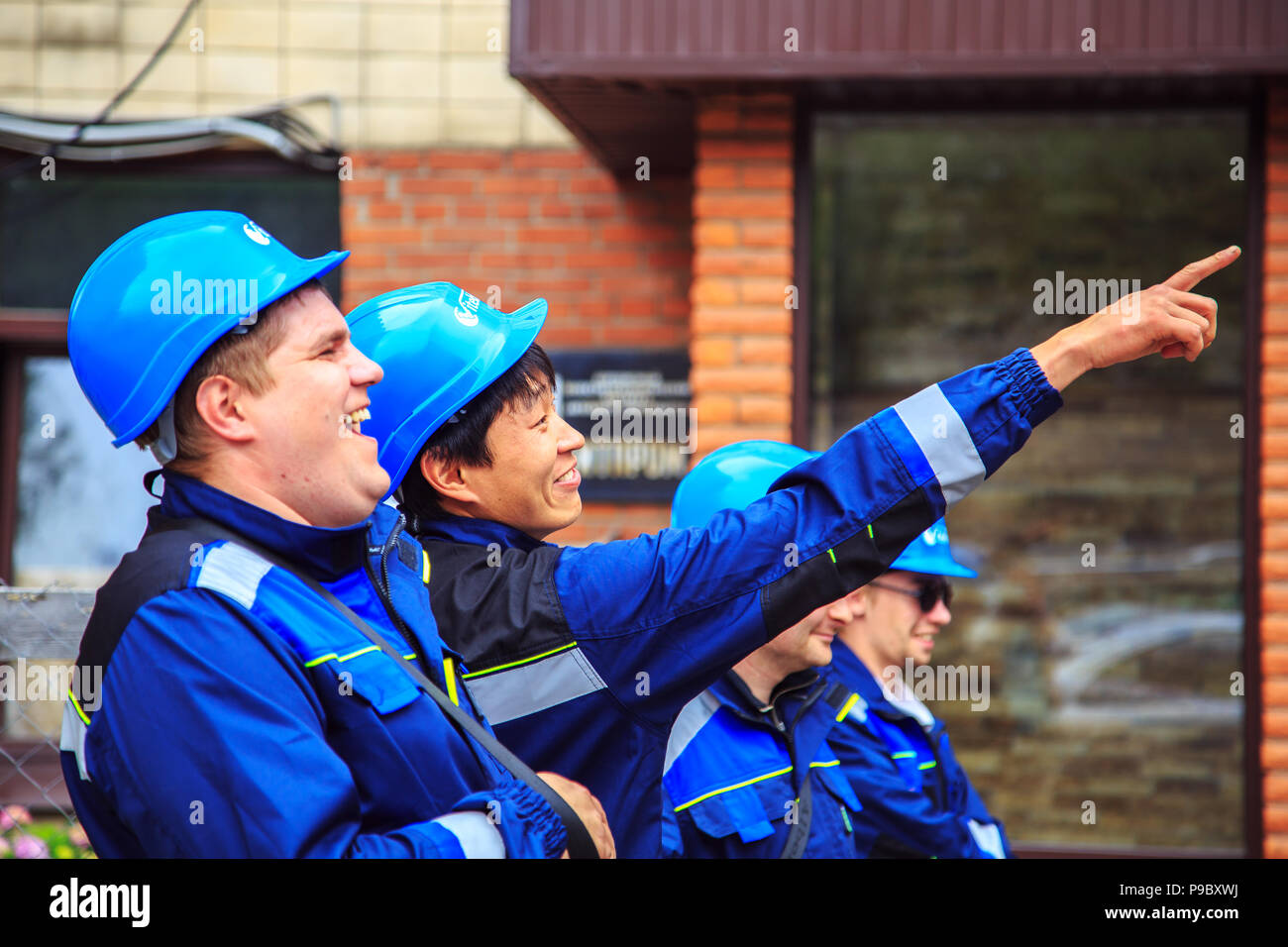 Group of  builders in hardhats. Business, building, teamwork and people concept. - Stock Image