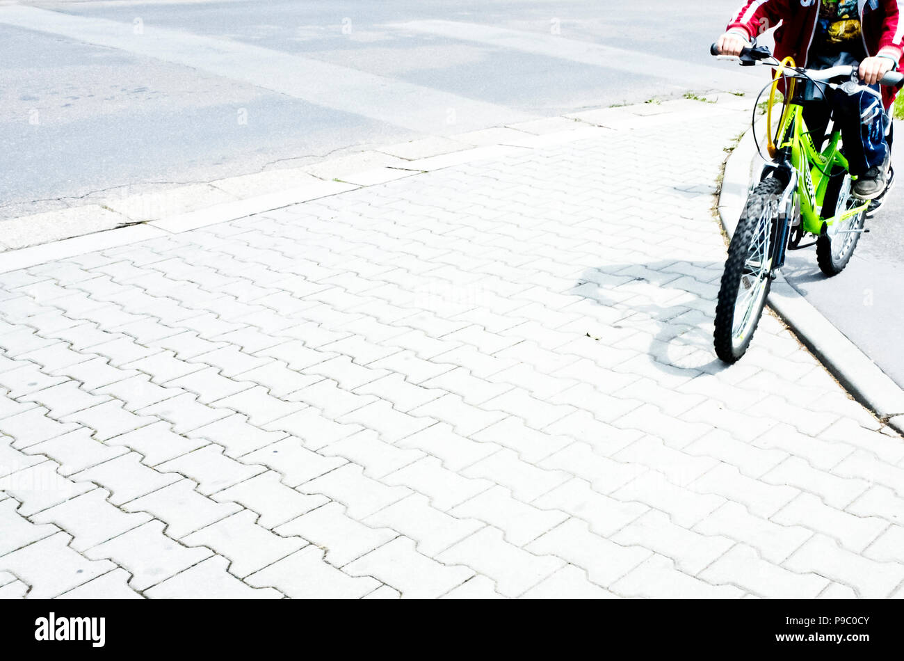 boy on a bicycle in the street, face not visible - Stock Image