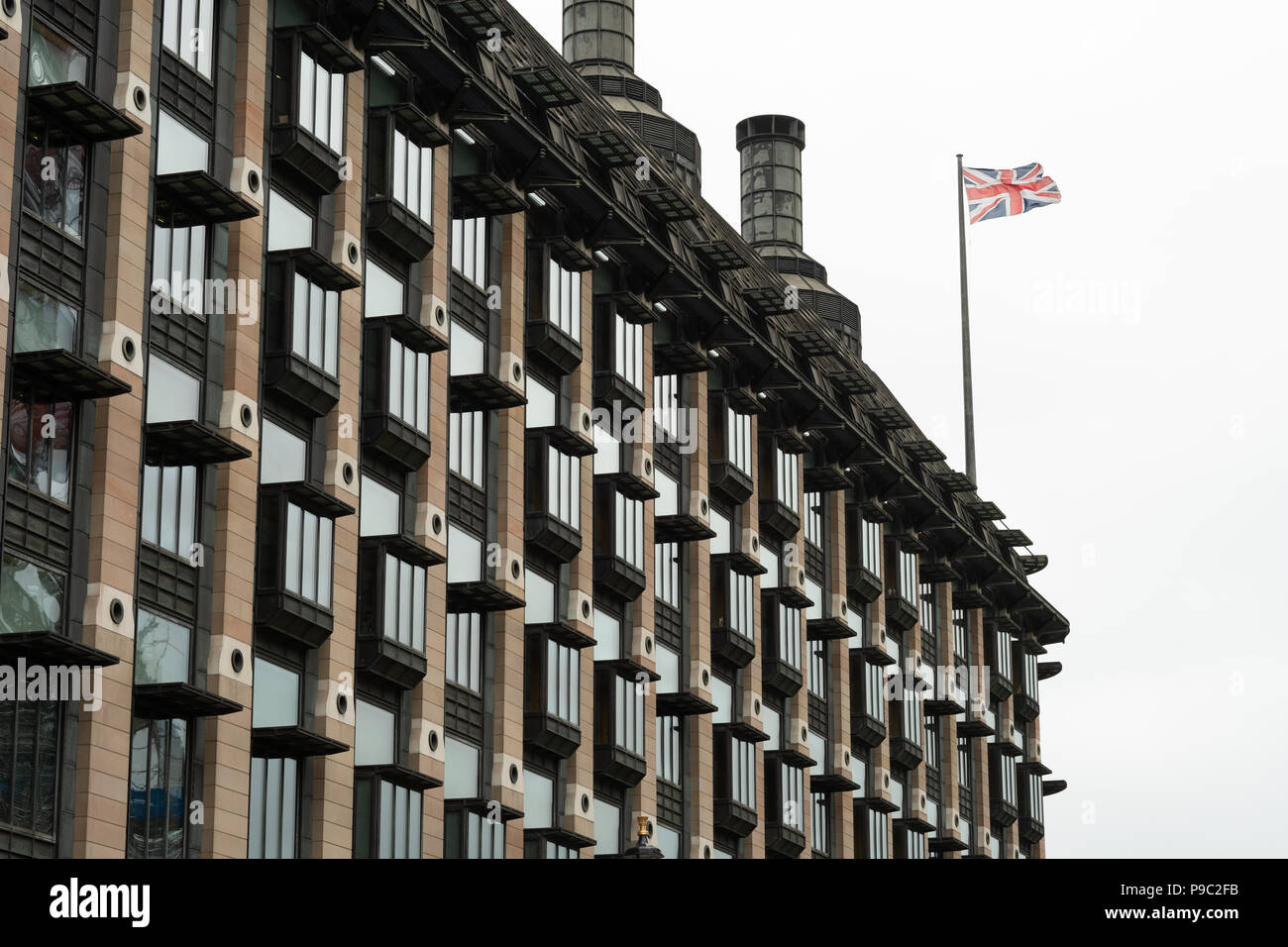 Portcullis house rooftop and Union Jack flag - Stock Image