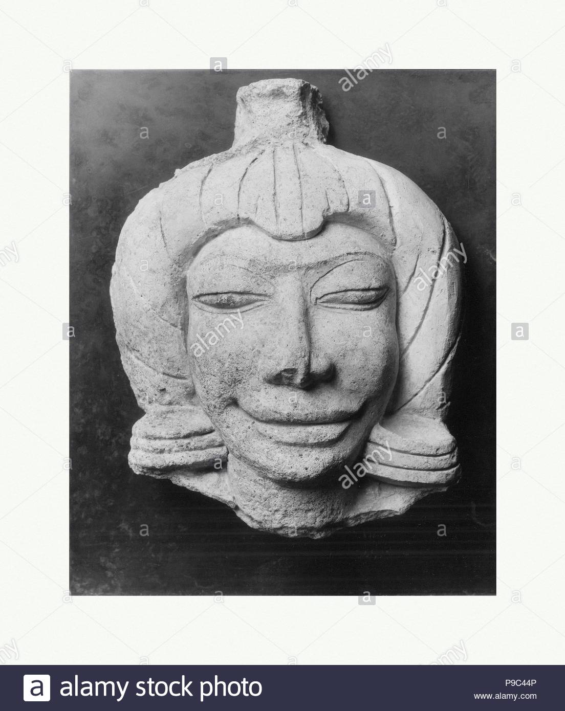 Head of a Male Figure, Mon-Dvaravati period, 8th–9th century, Thailand (Ratchaburi Province, Ku Bua), Stucco with color, H. 6 7/8 in. (17.5 cm), Sculpture, In Thailand, stupas and temples were often embellished with terracotta and stucco sculptures. In some instances, even large-scale narrative friezes illustrating stories from the Buddha's life survive. In contrast to the stone and metal images that served as the primary objects of worship, these sculptures in plastic media show a greater degree of spontaneity and freedom of expression. - Stock Image