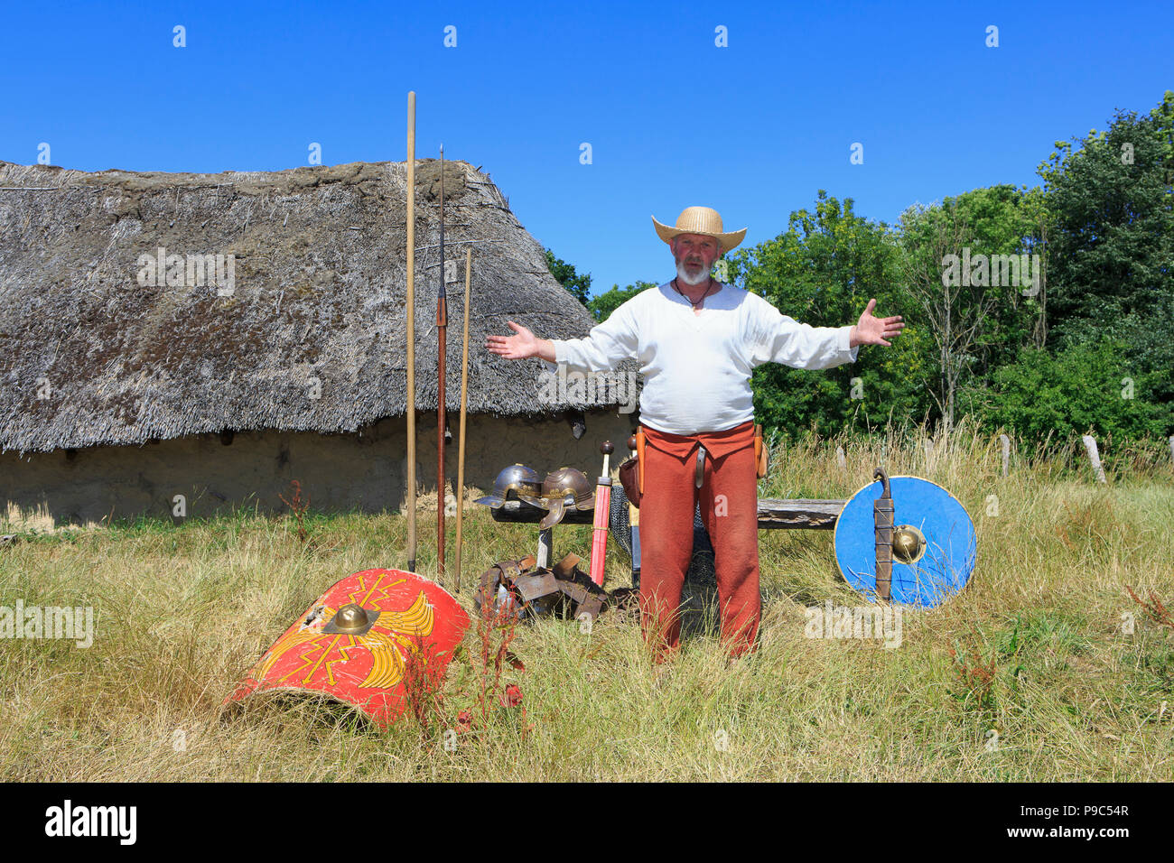 An archaeologist/historican showcasing and explaning about ancient weaponry at The Land of Legends in Lejre, Denmark - Stock Image