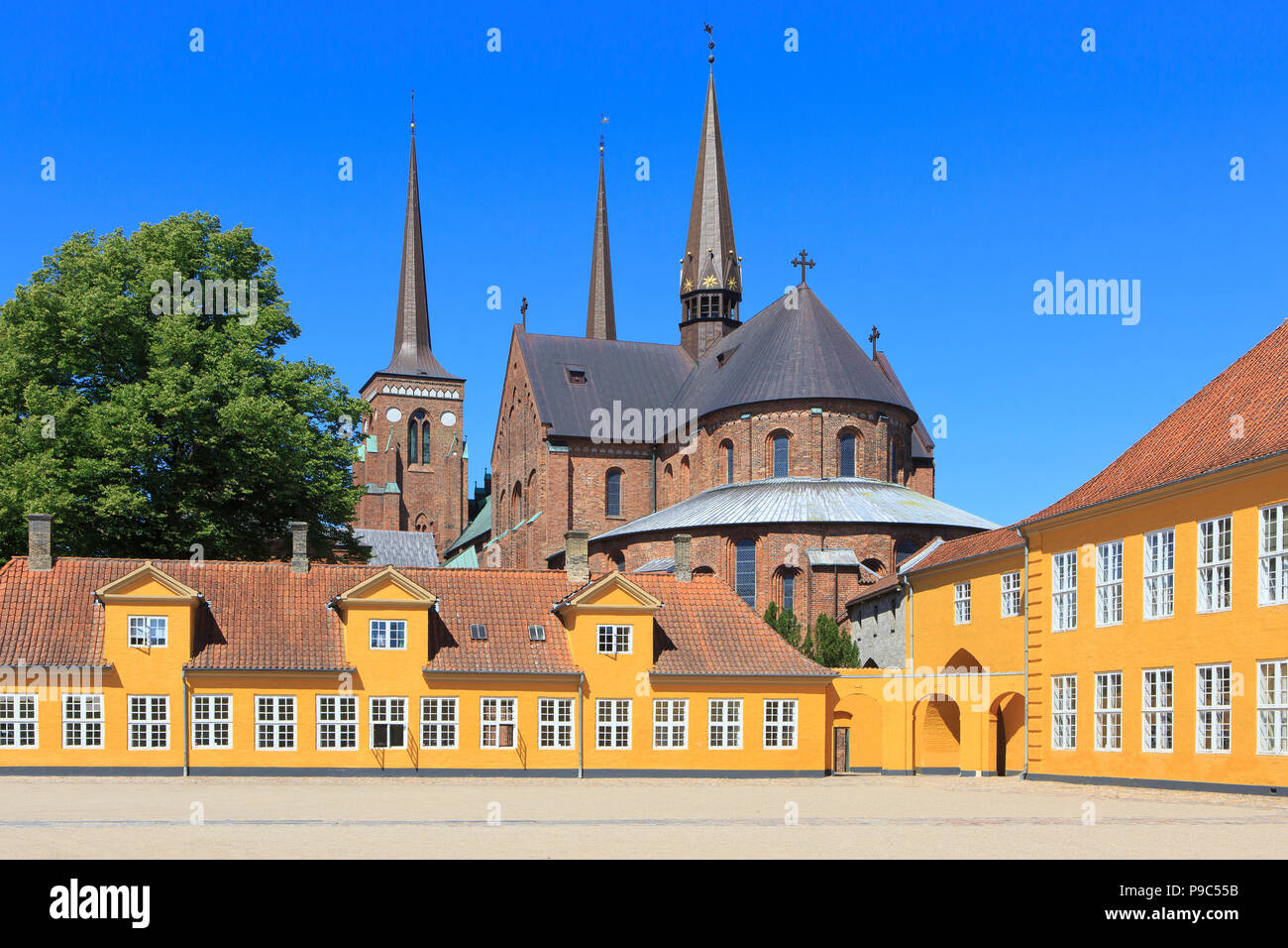 The 12th-century brick Gothic Roskilde Cathedral seen from the Bishop's House in Roskilde, Denmark - Stock Image
