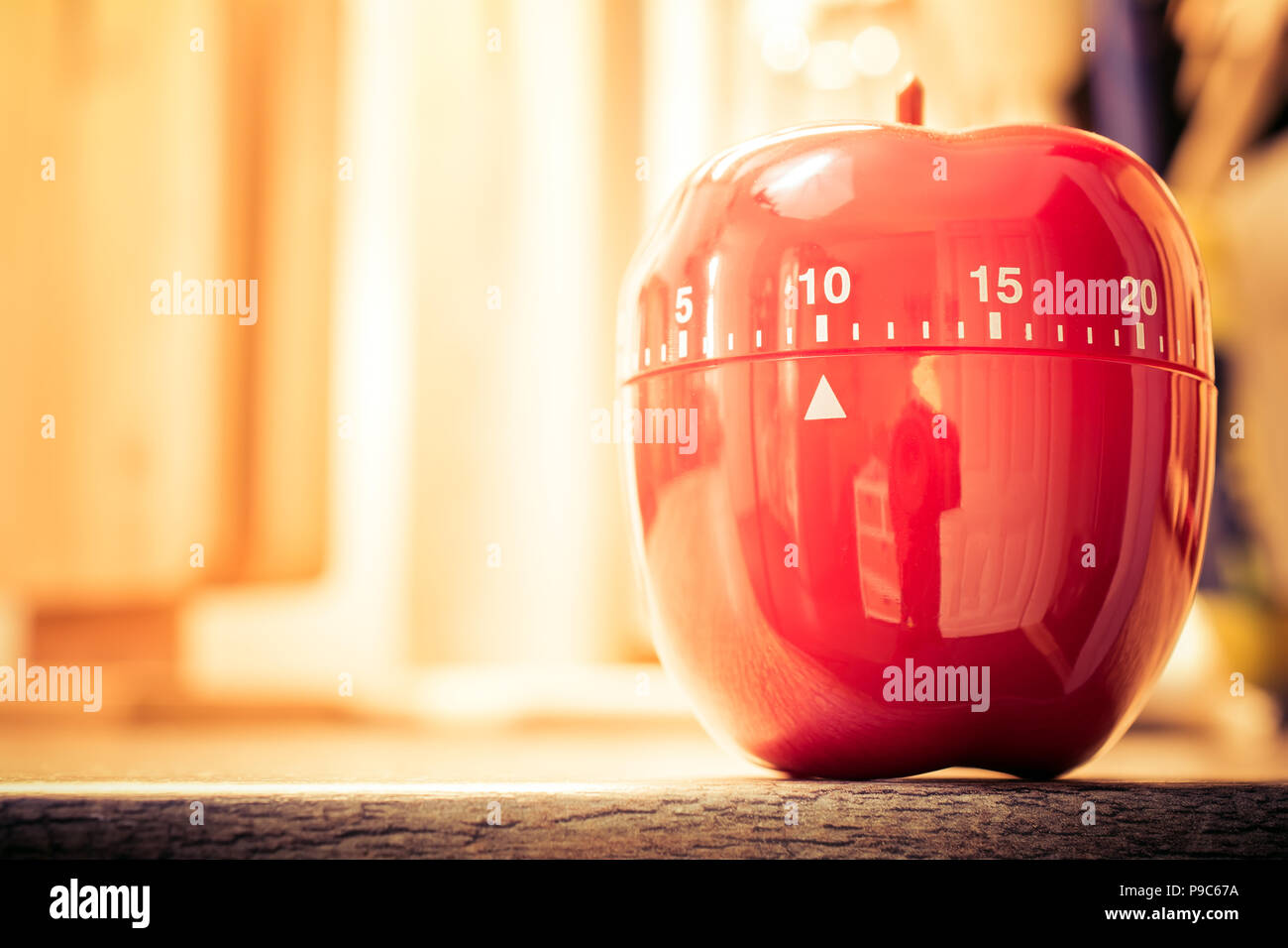 10 minutes red kitchen egg timer in bright atmosphere stock image