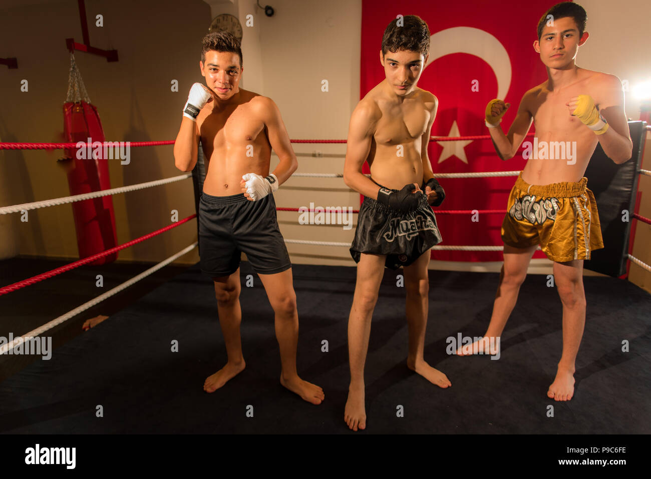 Junior Child Muay Thai KKck boxer preparing for UFC, MMA, K-1, GLORY cage fight - Stock Image