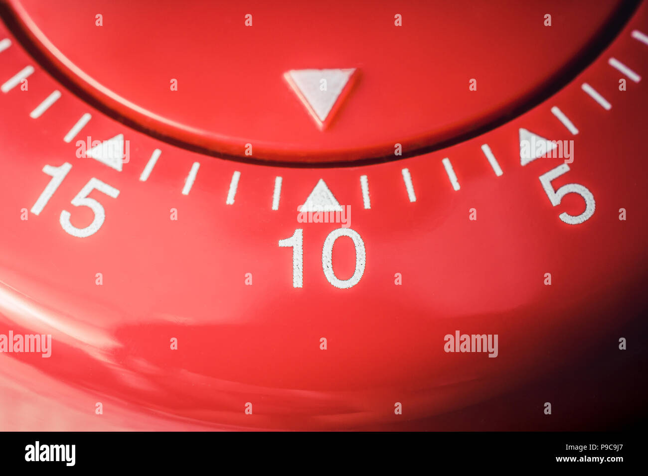 10 minutes macro of a flat red kitchen egg timer stock photo