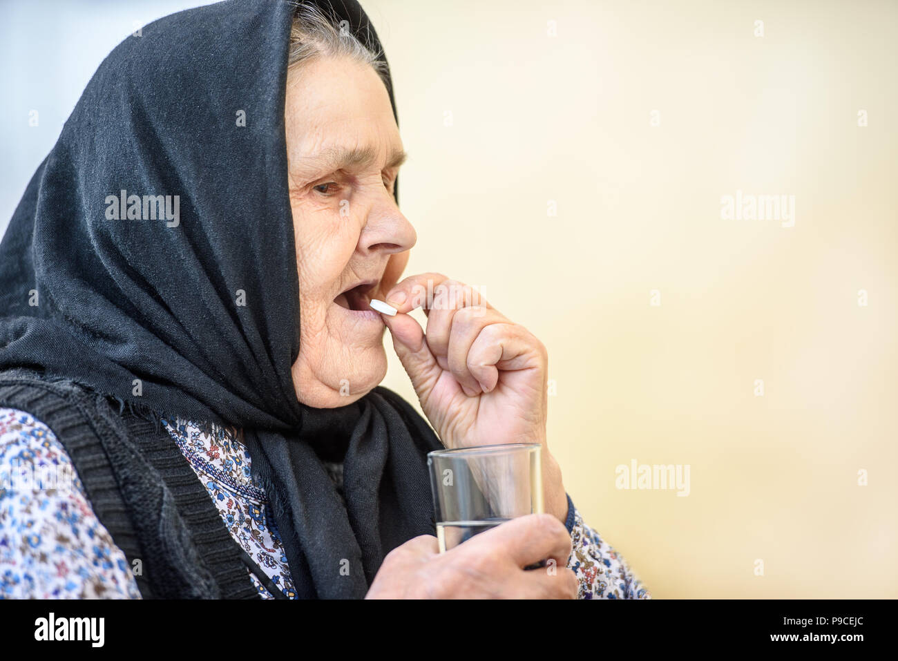 Grandmother, pill, health and the concept of a healthy lifestyle - an old woman takes pills Stock Photo