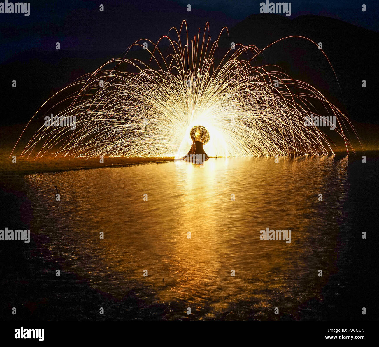 Ring of fire with long exposure at night. Light background. Stock Photo