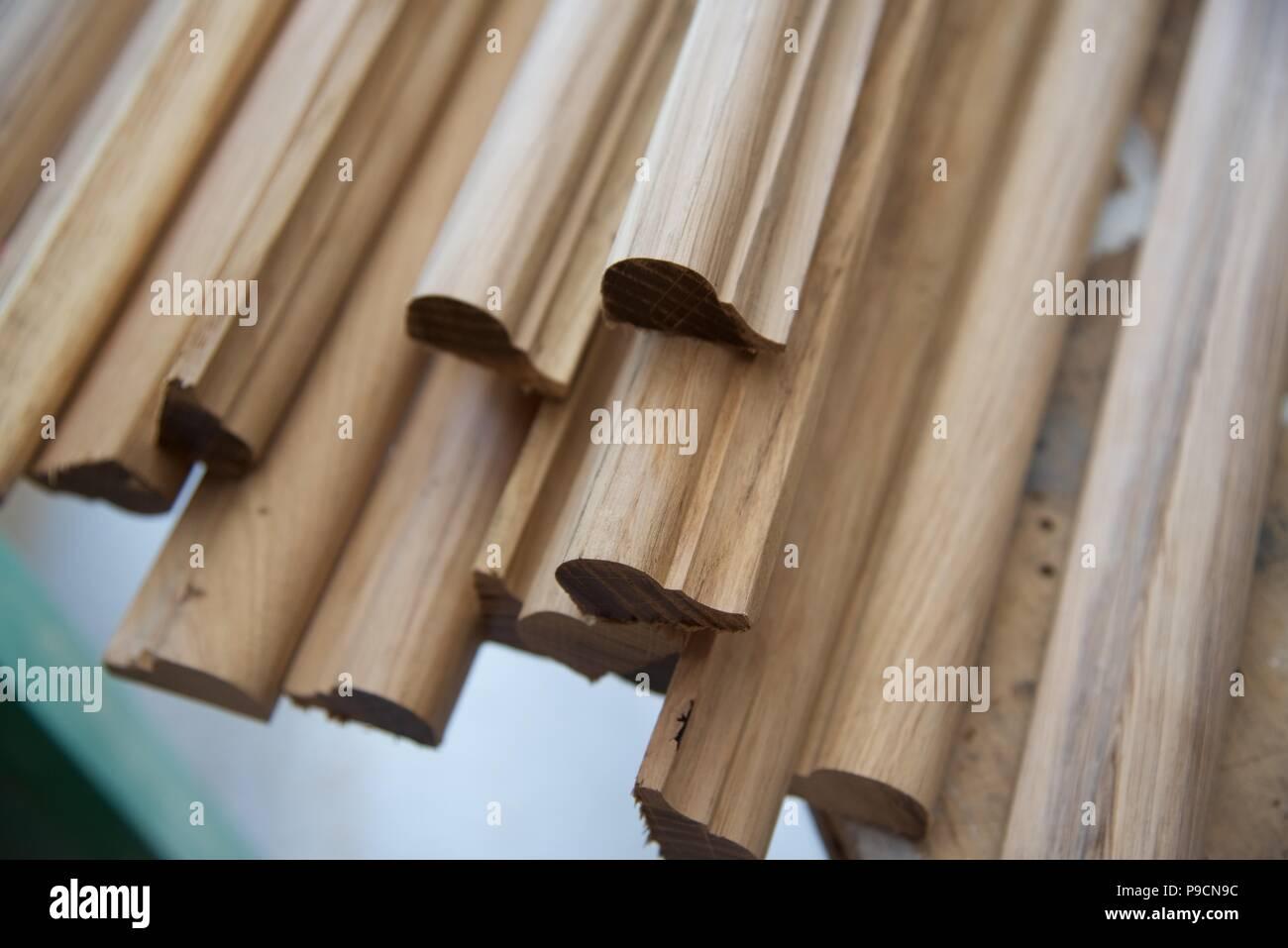 Oak mouldings: a number of lengths of decorative oak nosing - Stock Image