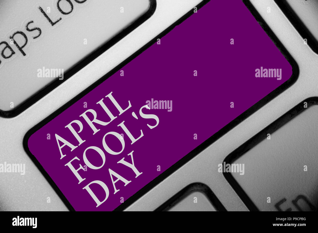 Handwriting text April Fool s is Day. Concept meaning Practical jokes humor pranks Celebration funny foolish Keyboard button hit key type message offi - Stock Image