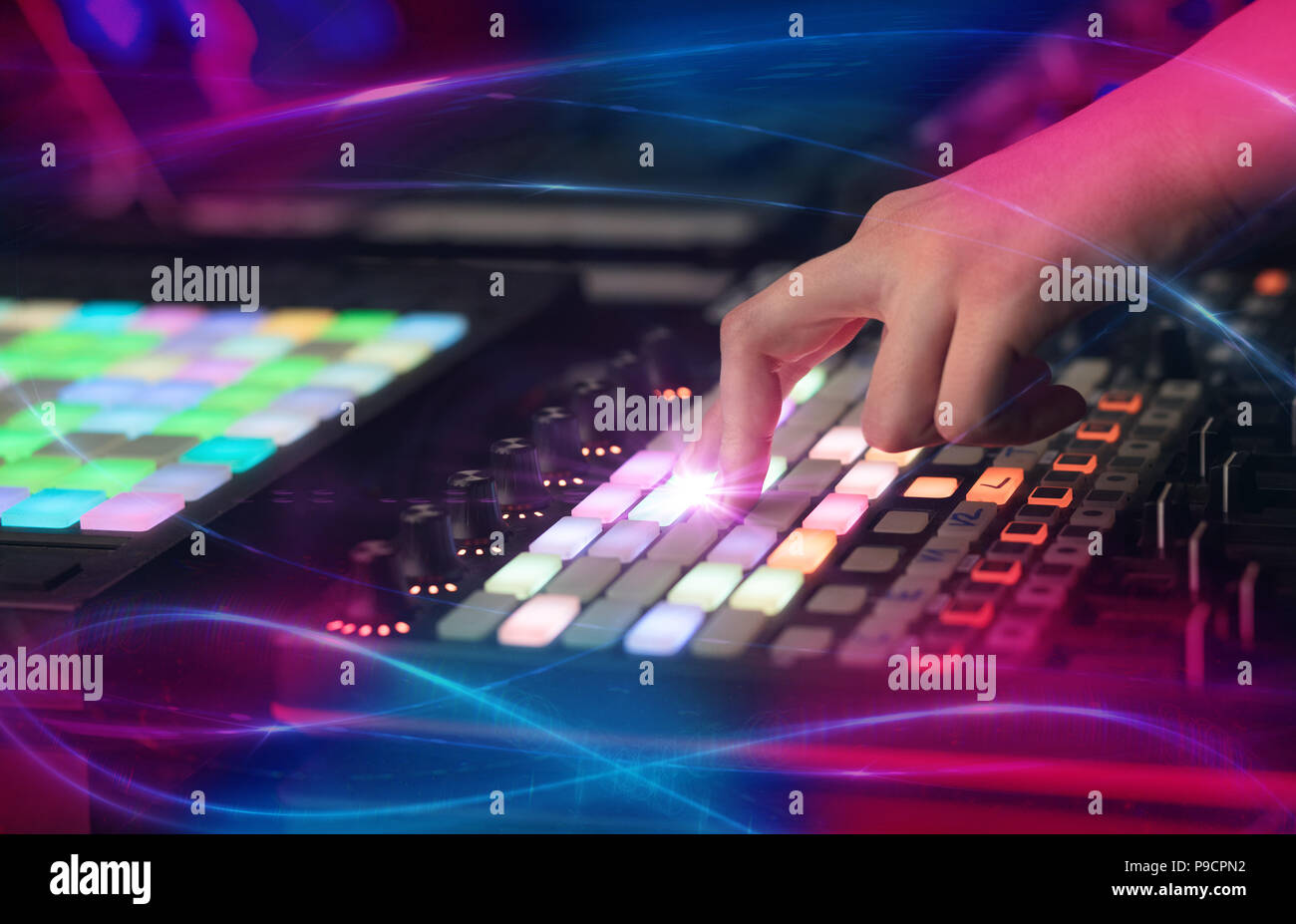 Hand mixing music on midi controller with wave vibe concept  - Stock Image