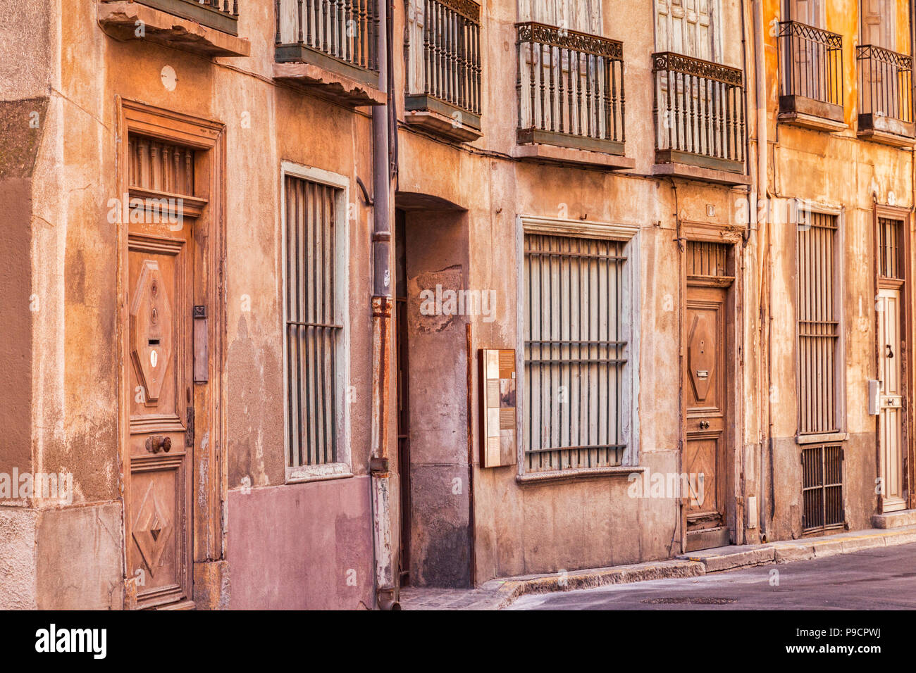 Old apartment buildings in Rue de l'Horloge, Perpignan, Languedoc-Roussillon, Pyrenees-Orientales, France. - Stock Image