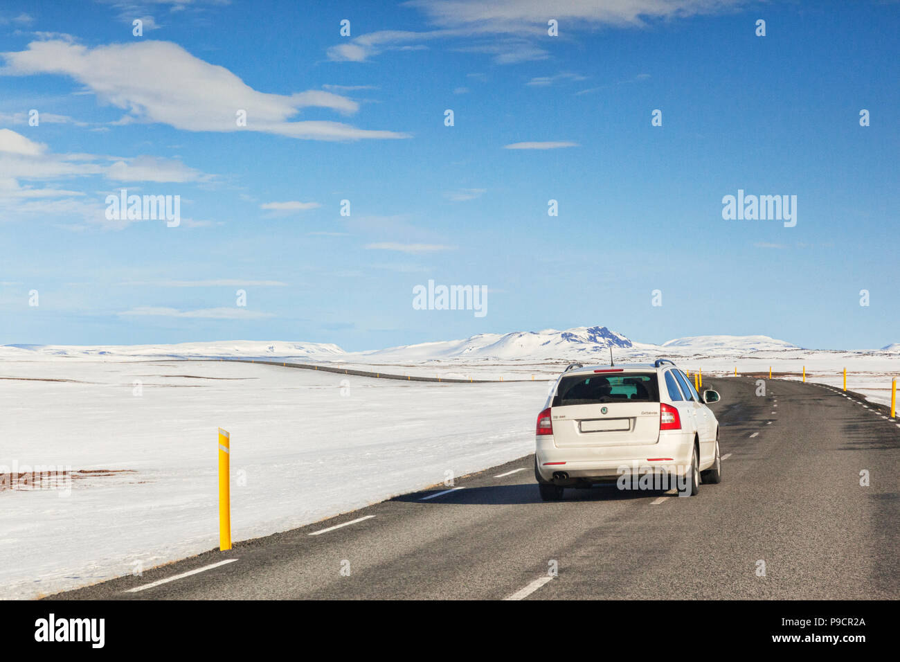 12 April 2018: North East Iceland - Car travelling the Iceland Ring Road, in the North East of the Country, on a beautiful spring day. - Stock Image