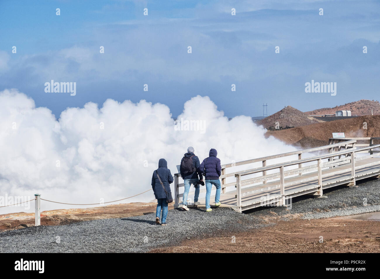 18 April 2018: Reykjanes Peninsula, Iceland - Tourists at Gunnuhver Hot Springs. - Stock Image
