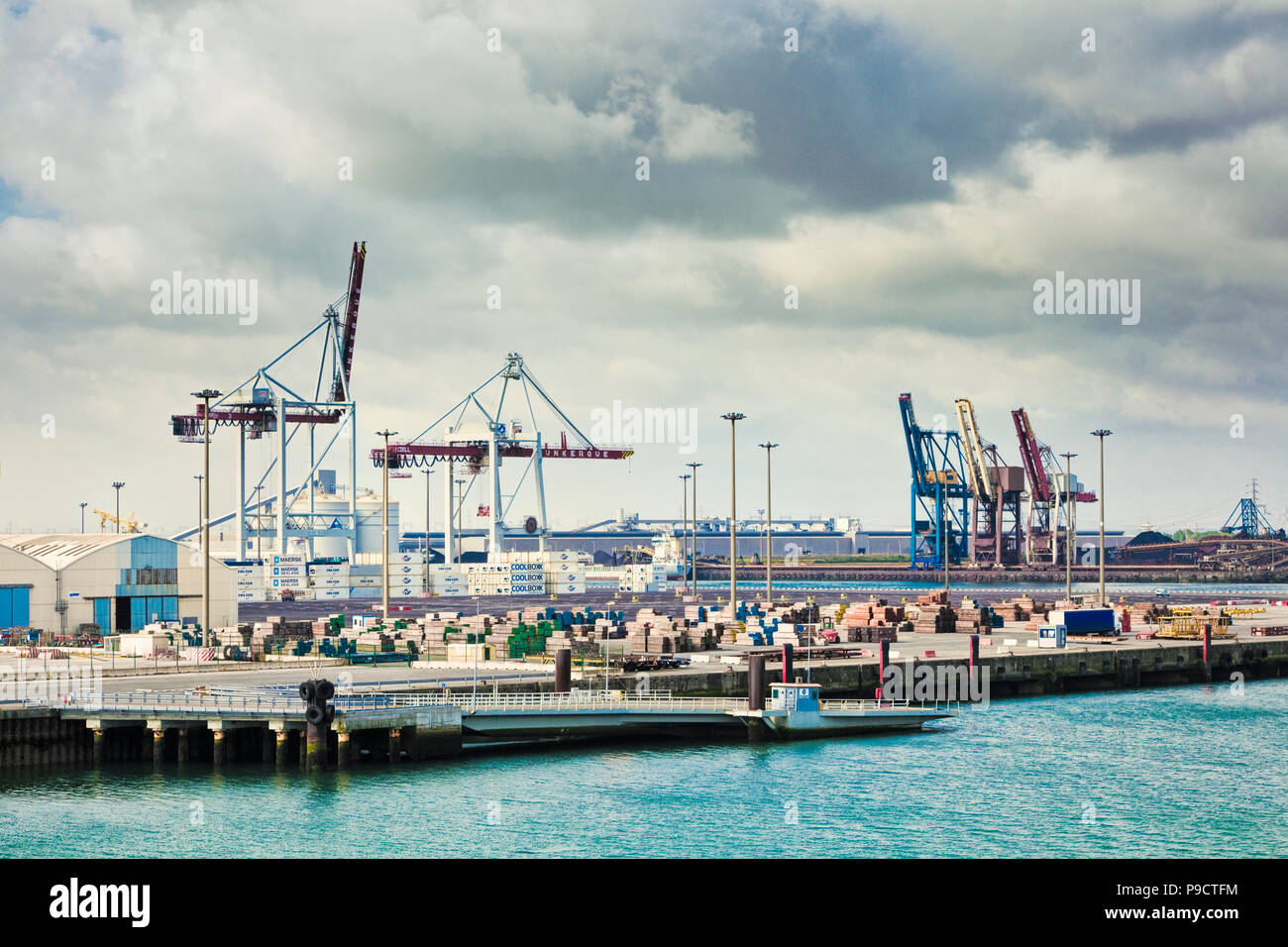 Cranes on the docks at the industrial port of Dunkirk, France, Europe - Stock Image