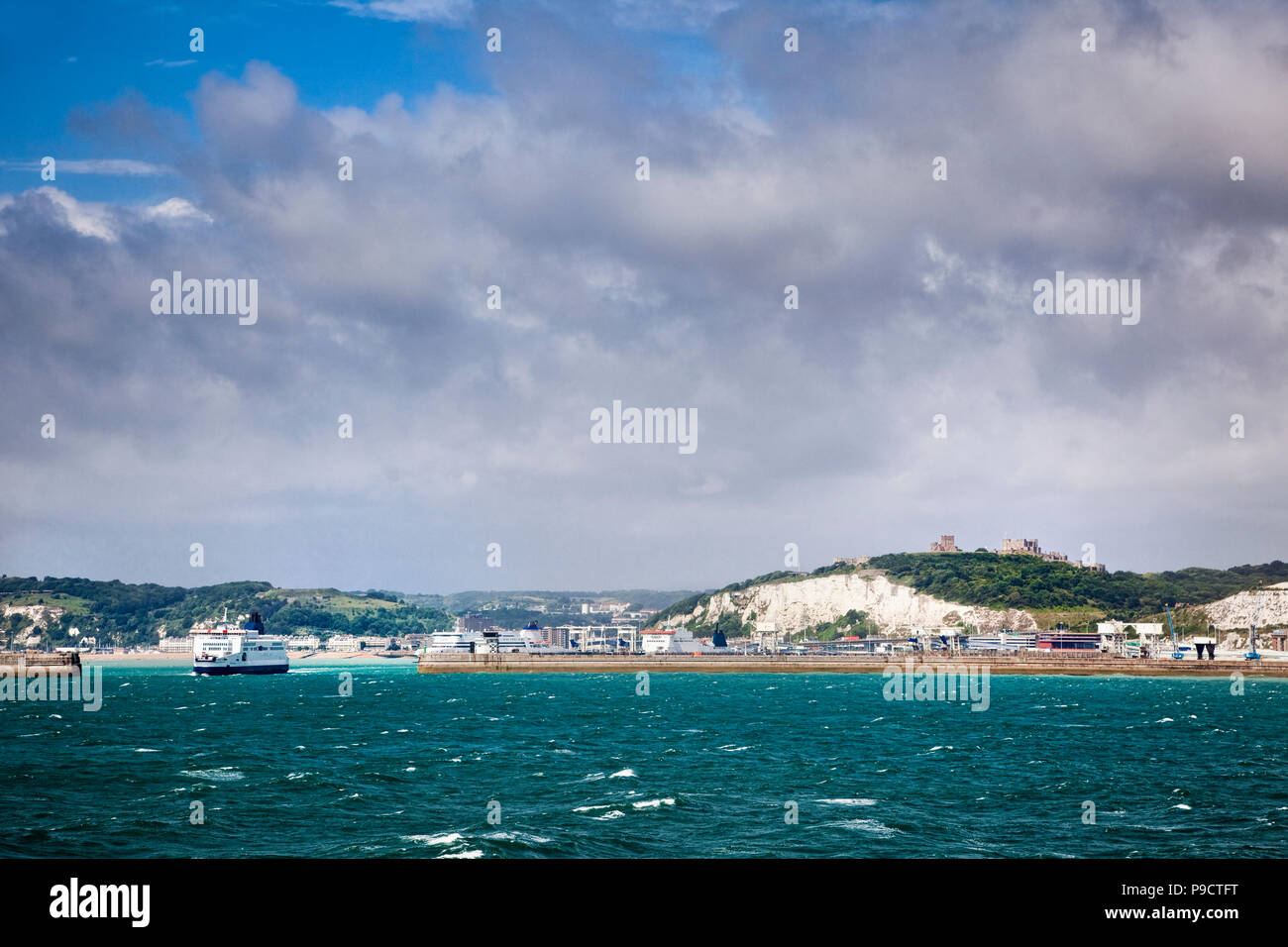 Car ferries, the harbour wall and Dover Castle above the ferry port of Dover, Kent, England, UK Stock Photo