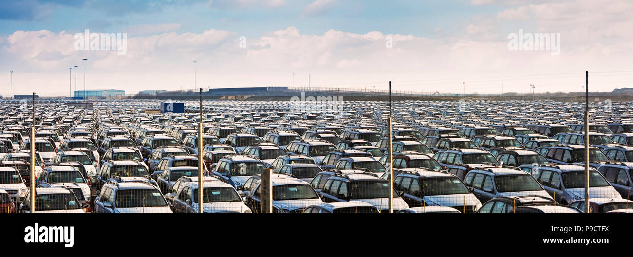 Thousands of imports of new imported cars parked in rows at Immingham Docks, Lincolnshire, England, UK - Stock Image