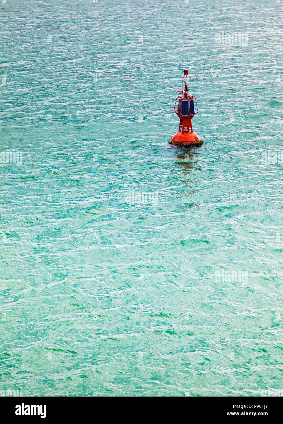 Solar powered navigation buoy in a calm sea, France, Europe - Stock Image