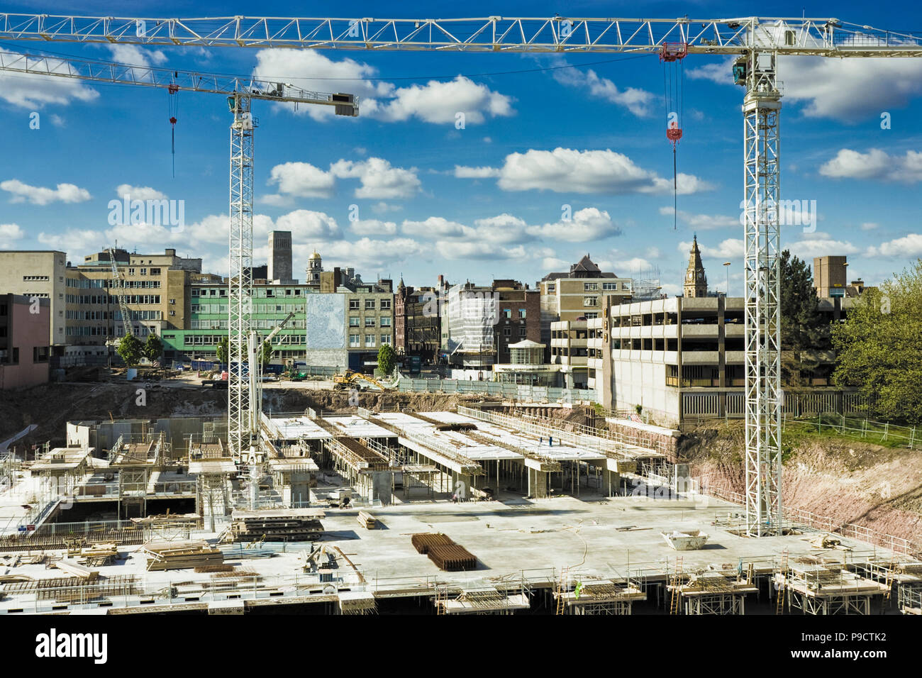 Tall cranes at an inner city construction site, England, UK - Stock Image