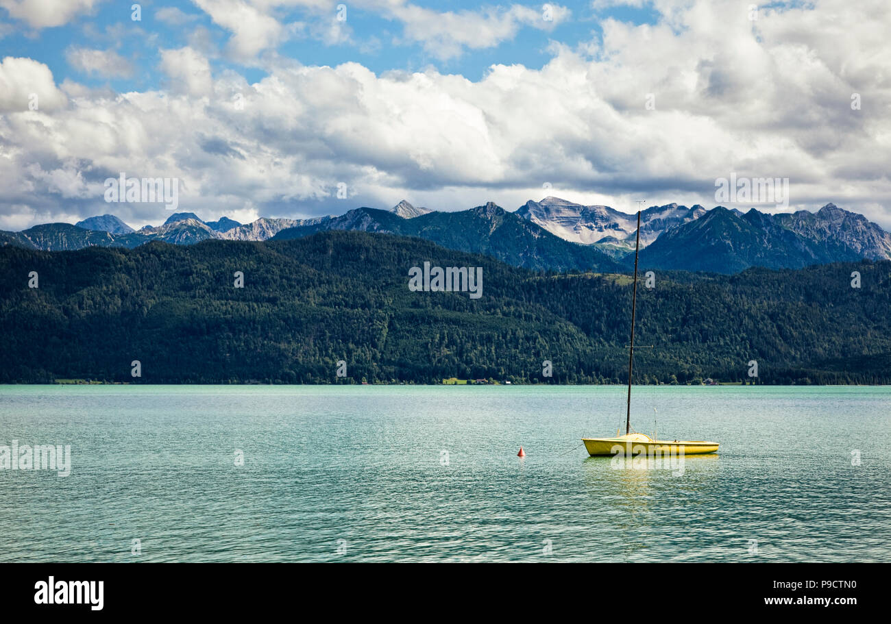 Small sailing boat moored on Lake Walchensee, Bavaria, Southern Germany, Europe - Stock Image
