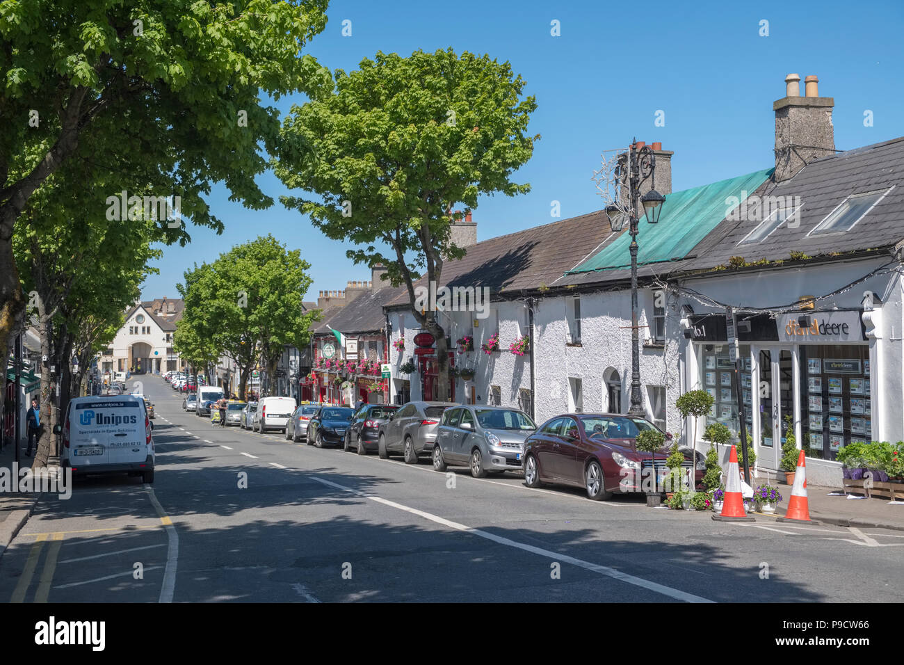 Shopping street in Malahide, a trendy affluent coastal town in Fingal, Leinster, County Dublin, Ireland, Europe - Stock Image