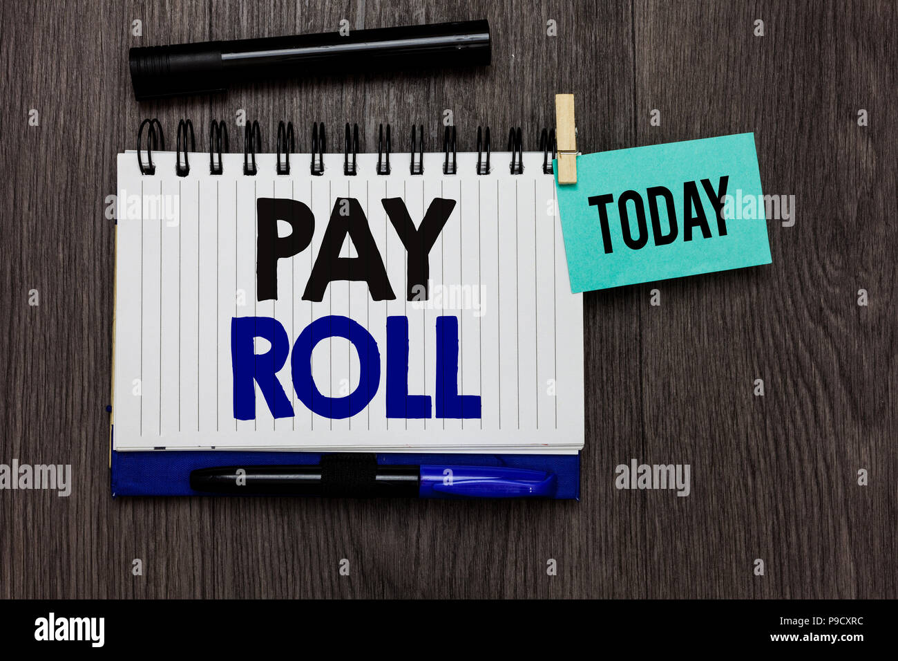 Conceptual hand writing showing Pay Roll. Business photo text Amount of wages and salaries paid by a company to its employees Ideas notebook wooden ta - Stock Image