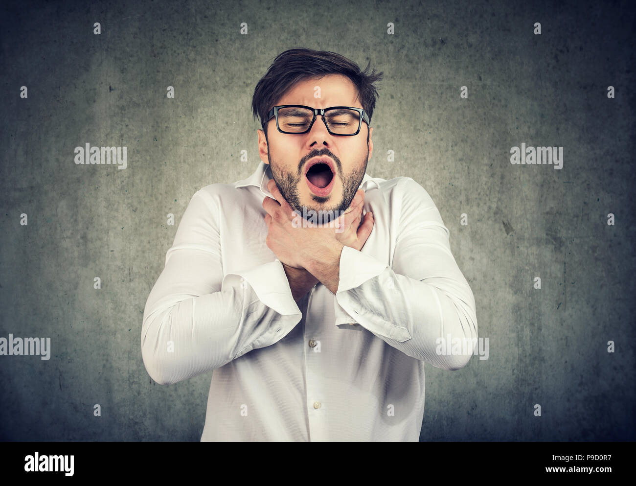 Young man having asthma attack or choking can't breath Stock Photo