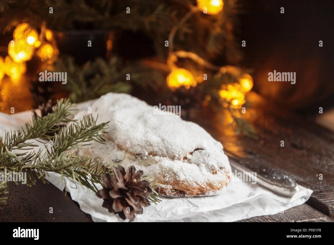 Dresden Stollen is a Traditional German Cake with raisins on a light ...