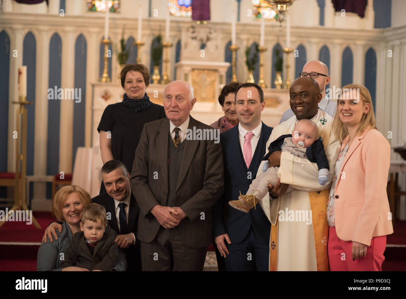 Christening baby ritual catholich Church Ireland - Stock Image