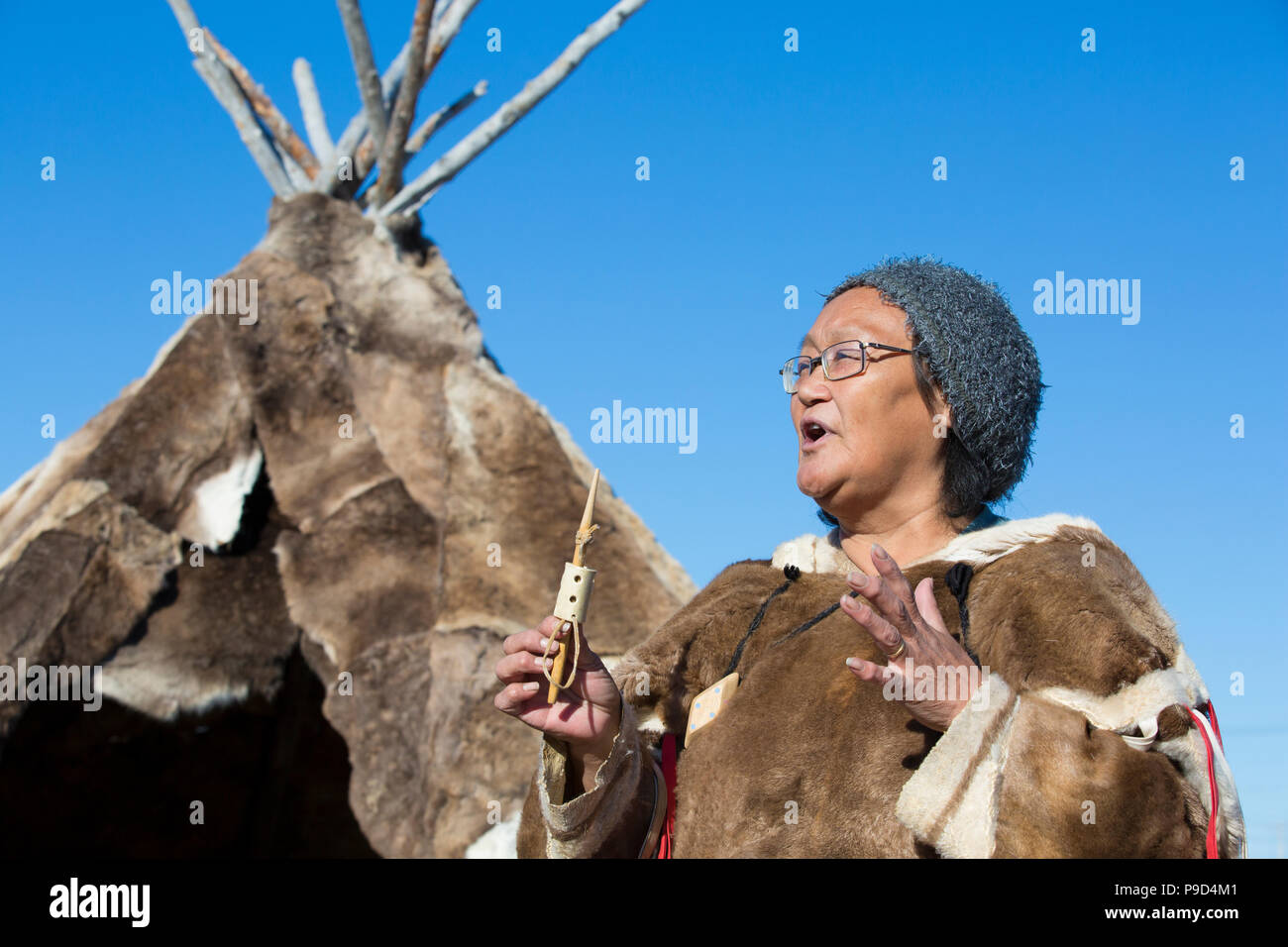 Canada, Nunavut, Hudson Bay, Kivalliq, Arviat, local woman demonstrates historic tools used by inuit. - Stock Image
