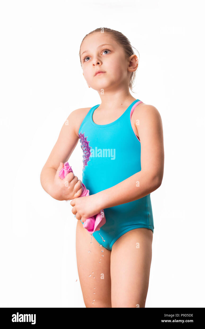 9a74454676e Little caucasian 7 years old cute caucasian girlie in cyan swimming costume  twistting a pink shammy