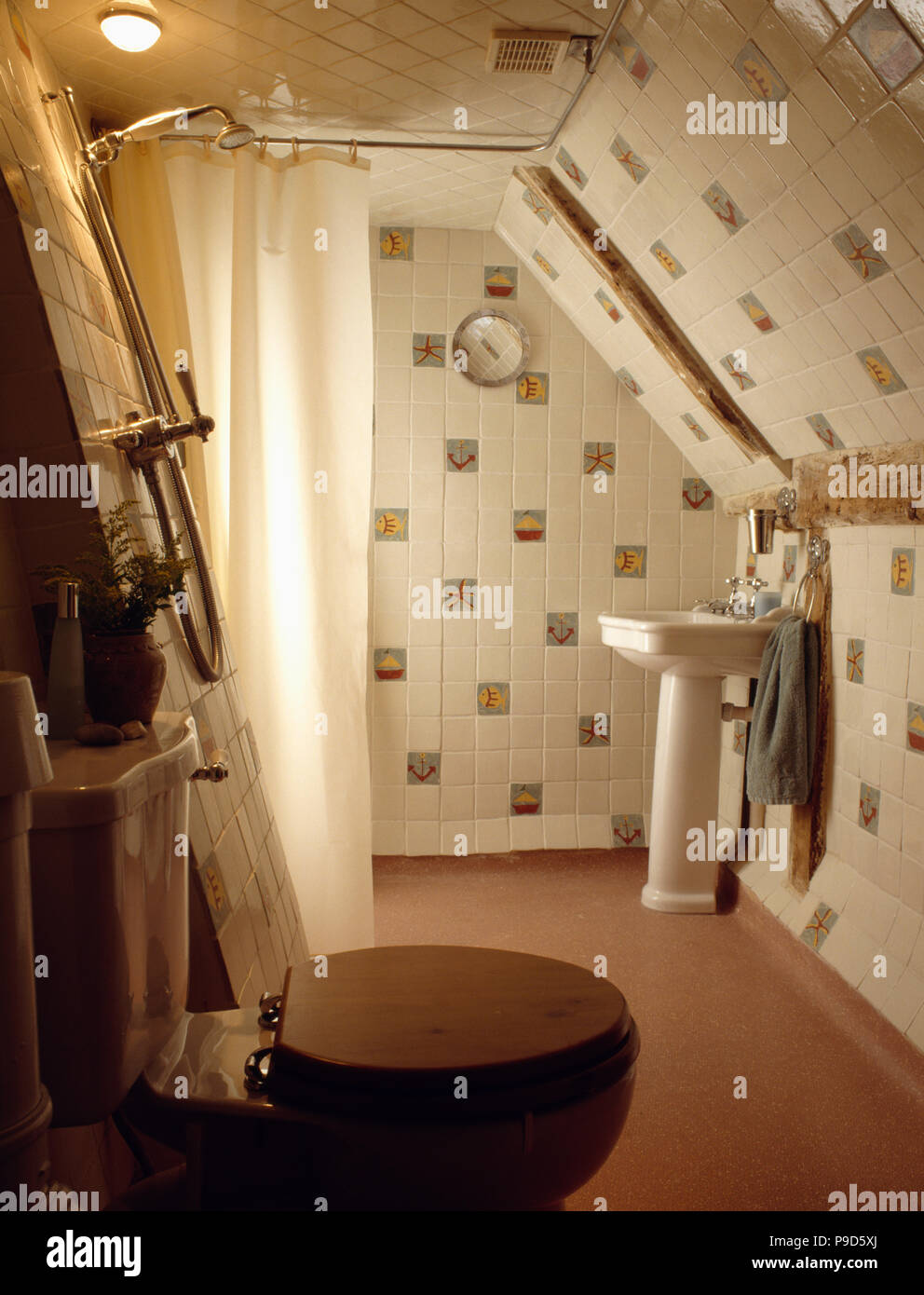 Wooden seat on toilet in tiled attic shower room Stock Photo ...